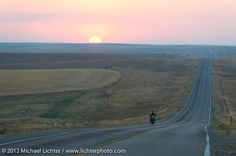 Buck Carson (#3) riding his 1927 BSA 500 single as the sun rose behind him. Motorcycle Cannonball II pre-1930 Coast-to-Coast Endurance Run. Stage 7 - Murdo, SD to Sturgis, SD. USA. September 13, 2012. Photography ©2012 Michael Lichter.