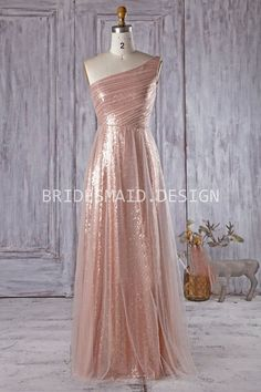 Tulle over pink gold sequins A-line long modern chic bridesmaid dress asymmetrical one shoulder neckline. It is pure glamour and gives definition to flowing dress.