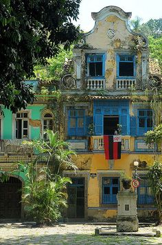 This old building is located Rio de Janeiro, Brazil.  I love that even through the wear and tear you can see the detail that goes into this building.  I love the colors, makes it seem like such a happier place with such bright colors.