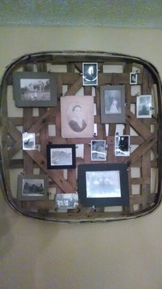 Early 1900 family photos on antique  tobacco basket hung on dining room wall. My new favorite home decor. Love that it's my own family