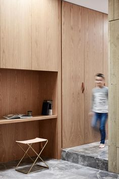 A a spacious, two-storey, contemporary industrial family home in Melbourne, by architect Craig Tan, inspired by a minimal zen Japanese aesthetic.