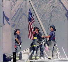The Rising -- New York City fire fighters raising the American flag in the wake of the terrorist attacks of September the 11th 2001.