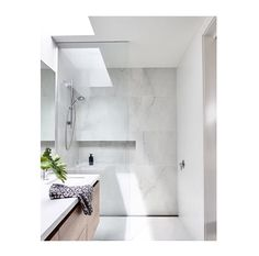 We love a Skylight in a bathroom! Oh so clean. We love a Skylight in a bathroom! Oh so clean. Ensuite Bathrooms, Bathroom Renos, White Bathroom, Bathroom Interior, Small Bathroom, Master Bathroom, Bathroom Marble, Washroom, Bathroom Inspo