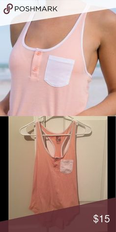 Nollie tank top Pink and white. Great condition! Pocket tank top. Racerback. Loose fitting. Darker pink then first picture. Simple. great with ripped jeans and sandals!  Nollie Tops Tank Tops