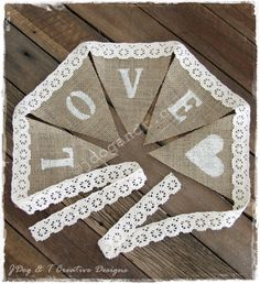 """Burlap and lace bunting...cake table """"love is sweet"""" :)"""