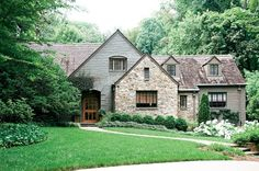 Love this cottage styled home. The largest triangle shape would look amazing with a classic swoop seen in many cottages.