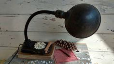 Check out this item in my Etsy shop https://www.etsy.com/listing/156171959/antique-industrial-style-gooseneck-cast