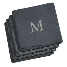 """These 4"""" square genuine natural slate coasters feature textured edges and 4 padded feet on each coaster. Intended as coasters, we've heard of uses as mini-cheese or snack servers, and even buffet signs too. Write on them with chalk - it wipes clean with a damp cloth. You can add a laser etched monogram, too (engraving available - check for additional cost if applicable). The set of four makes a great housewarming or wedding gift. Gift boxed."""