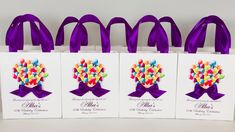 Birthday celebration gift bags with satin ribbon handles, bow, balloons and custom name. Elegant Personalized party gifts & favors for guests #partyfavors #partyideas #partygifts #favorbags #favorideas #favors #birthdayparty #giftbags #personalizedgift #purpledecor #birthdaycelebration #birthdayballons #birthdayfavors #60thbirthday #elegantpartydecor