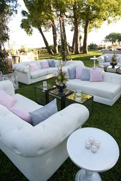 Create a lounge area for your reception and play up the colors of your wedding with the pillows.