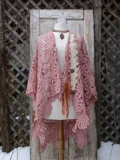 Beautiful vintage crochet which I have turned into a bohemian jacket with more vintage crochet trim,vintage buttons and ribbon by lapel and arm