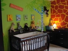 Main Wall - It's a JUNGLE in Here! I painted the walls of our colorful jungle theme nursery freehand. I actually got my nursery decorating ideas from a pair of wild socks that I received