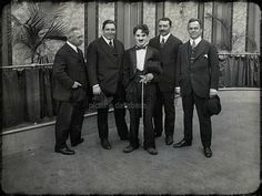 """Charlie Chaplin on the set of """"The Rink"""" (1916). With him, famed Irish Tenor John McCormack (large gentleman to his immediate right)."""