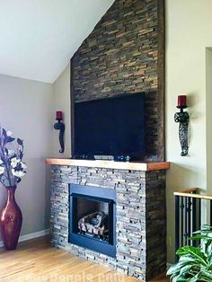 This gorgeous fireplace was accented with our faux stone panels. See more examples on our website!