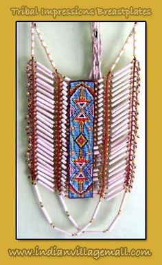 Warrior's Pipe Bone Beaded Breast Plate  This striking Hair Pipe Breastplate is decorated   with beads and has center hand beaded strip. Very stricking and sharp looking. - Review the Tribal Impressions Breastplate collection off of: http://indianvillagemall.com/dreamcatchers/breastplates.html