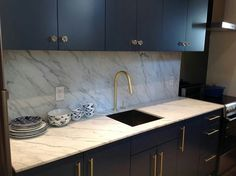 dark cabinets & white veined marble...