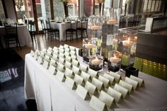 The sign in table was simple with black gems and floating candles. Wedding Dress Cost, Tea Length Wedding Dress, Wedding Dresses, Black And White Centerpieces, Cheap Wedding Venues, Wedding Ideas, Wedding Reception, Wedding Inspiration, Wedding Loans