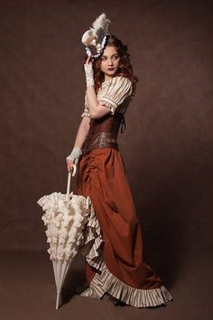 Warm Steampunk Color Palette (brown, ruse, orange, cream, with lace and stripes) - For costume tutorials, clothing guide, fashion inspiration photo gallery, calendar of Steampunk events, & more, visit SteampunkFashionGuide.com