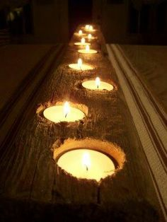 Drill holes into wood. Puttea candles in holes