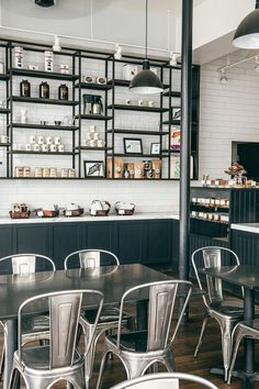 industrial styled coffee shop with metal furniture and dark metal shelves