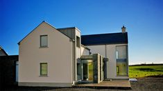 Designed as an evolution of the traditional form and located next to the main Sligo-Donegal road, the super insulated and triple glazed house minimises the noise pollution from the busy road in addition to its energy rating. House Designs Ireland, Types Of Houses, Construction, House Front, Minimalism, Shed, Exterior, Outdoor Structures, Architects