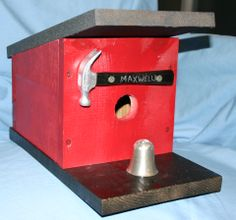 Maxwell's Place Bird House.  Hammer is from a child's tool kit, from the 70's. The perch is a bartender's shot measure.
