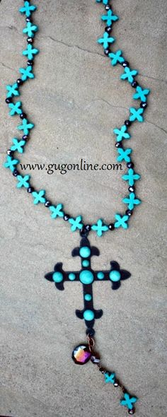 Shop now at www.gugonline.com Turquoise Chopper Beads with Dangle Bronze Metal and Turquoise Stud Chopper Cross