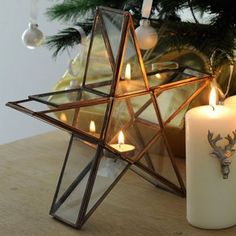Standing 26.5cm high this attractive tealight holder gives off lovely twinkling light through the glass panels and the stylish copper finish make it an attractive addition to any home. http://www.harrodhorticultural.com/star-tea-light-holder-pid9570.html