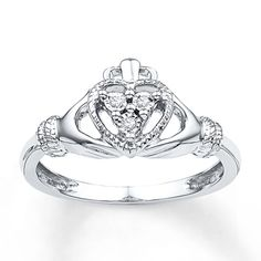 This meaningful Claddagh ring is a traditional symbol of love, friendship and loyalty. Beautifully crafted in sterling silver, the ring for her shimmers with diamond accents in the center. Diamond Claddagh Ring, Claddagh Rings, Diamond Rings, Diamond Jewelry, Silver Necklaces, Silver Jewelry, Silver Rings, Titanium Jewelry, Celtic Wedding Rings