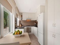 The renovated kitchen and meals area at the Mount Eliza home unit / apartment for sale.