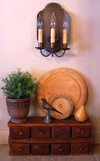 love this look! love chest and lighting fixture!! Realllllly shows how great the old bread boards are for decorating!!