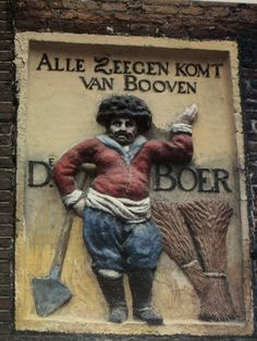 17de eeuw gevel, Nieuwendijk. Alle zegen komt van boven = All blessings come from heaven (boven means above in Dutch). De Boer is a common name in Holland. It means farmer.
