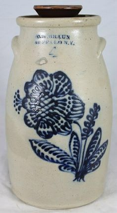 """C. W. BRAUN BUFFALO NY 4 gallon butter churn with stoneware guide.  Decorated with a large cross hatch flower design in great blue. Lots of dots and dashes create a masterpiece in blue. Additional blue at the maker's mark.    Minor surface chips at the interior rim and imperfections in the making. Professional restoration to a tight line under the right ear. EX Denlinger Auction Spring 1988 lot 120. 16 1/2"""" 1860 sold $ 6250"""