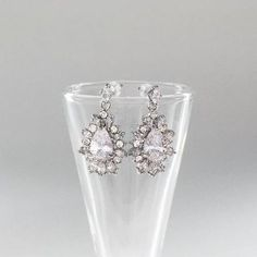 Amazing starburst design cz bridal earrings.  Affordable and beautiful bridal and wedding accessories and jewelry.  Bring on the bling at Adorn!