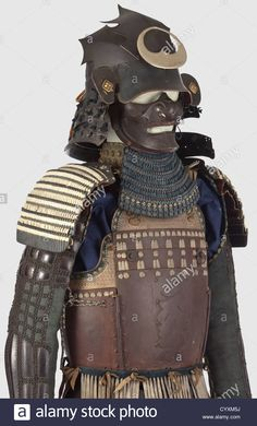 A Japanese suit of armour, middle to the end of the Edo period Assembled from old pieces. A hineno-kabuto with a five-lame hinen Stock Photo