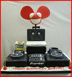 DJ Cake complete with turntables, mixer, MACBOOK, Cd's, Deadmau5, all customized to surprise the groom on his wedding day.   www.facebook.com/itsacakethingwoodbridge