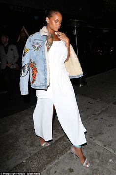 4d932e0e7a9 Rihanna flashes leg in white dress and statement denim jacket