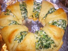 "Spinach & Chicken Wreath...looks like one of my favorite things to make when I sold Pampered Chef products. Once you learn how to make the ""wreath or ring"" you can fill with any mixture. Get creative with left over meats!"