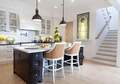 Benjamin Moore Simply White OC-117. White Kitchen Ebody Island. White Kitchen Cabinet with Ebony Stained Kitchen Island. #WhiteKitchen #EbonyIsland Graystone Custom Builders.