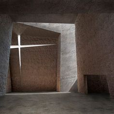 inspritational -Completed in 2008 by Spanish architect Fernando Menis of Menis Arquitectos, Church in La Laguna, Tenerife, comprises four chunky concrete volumes separated from one another by sliced openings, with surfaces roughly lined with crushed volcanic rocks.    Via Dezeen.