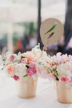 gold buckets filled with #pink florals #centerpieces | Photography: Mademoiselle Fiona - www.mademoisellefiona.com, Design and Florals by http://www.monplusbeaujour.com/, gold balloon table numbers by http://www.pinktoastink.com/