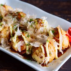 Takoyaki, Octopus Balls - Takoyaki, or Octopus Balls is one of Japan's best-known street food originated in Osaka. Whether you make traditional style with bits of octopus or other alternatives, these ball-shape dumplings are fun to make with your friends and family! #Japanesefood #partyfood #asianrecipes #takoyaki #snacks #dumplings #japanesestreetfood   Easy Japanese Recipes at JustOneCookbook.com