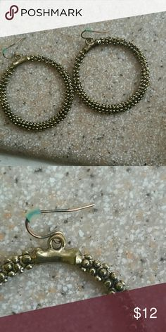 Goldtone caviar hoops Cluster of gold tone metal beads form hoops that hang from hypoallergenic fish hooks. Excellent used condition. Includes rubber stopper backs. Jewelry Earrings