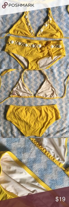 VS Yellow bikini set embellished with white stones Victoria's Secret Yellow bikini set embellished with white stones. Size S. Fabric: 80% Nylon, 20% Spandex. Liner: 93% Polyester, 7% spandex. Worn once before. In great condition. Victoria's Secret Swim Bikinis