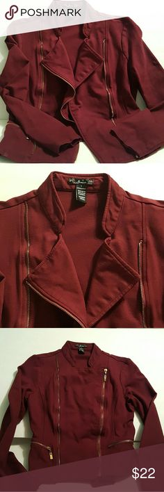 Burgundy Moto Jacket Burgundy long sleeve moto jacket. Very cute! Pair with jeans & a black tank & you're good to go! Gold toned zippers. Can wear zipped up or open. Size is Large though i find it runs small. So this can/will fit a small/Medium. 65.5%rayon 30.5%nylon 4%spandex gently used and is in great condition! Can also double as a blazer Jackets & Coats