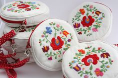 Handmade matyo embroidery bag  https://www.etsy.com/listing/113889947/hand-embroidered-round-purse-with?