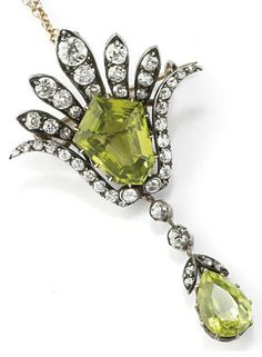 AN ANTIQUE PERIDOT AND DIAMOND PENDANT BROOCH. Designed as a palmette, set with old-cut diamonds, centring upon a hexagonal peridot, suspending a pear shaped peridot, surmounted by old-cut diamonds, with removable pin, circa 19th century.