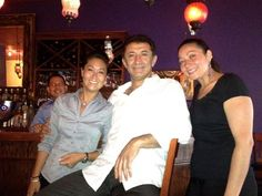 Emin Acar surrounded by staff at Turquoise Restaurant