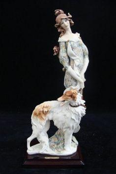 armani figurines on pinterest venus parrots and statues. Black Bedroom Furniture Sets. Home Design Ideas