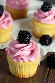 These blackberry vanilla cupcakes are soft vanilla cupcakes made from scratch and piped high with a tangy blackberry buttercream.